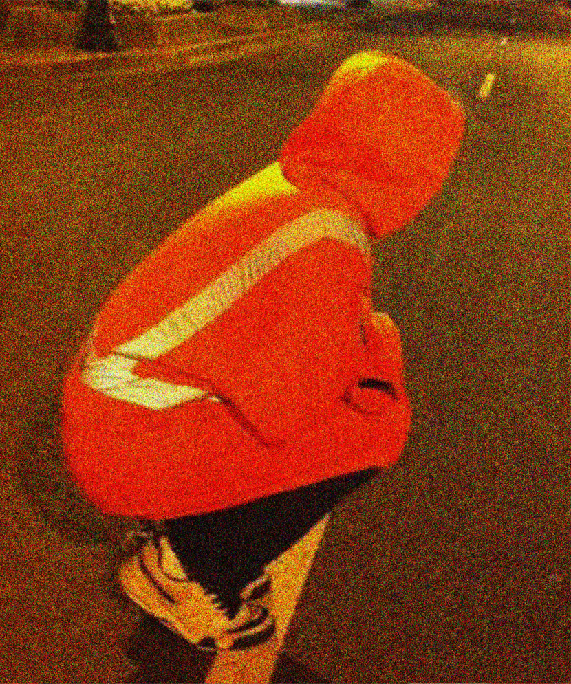 « Human Road Cone » (photo of Bryan Lewis Saunders by Robby Simpson)